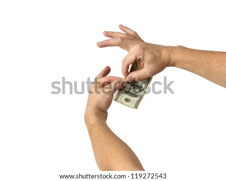 A businessman tears his money in half isolated on white - stock photo
