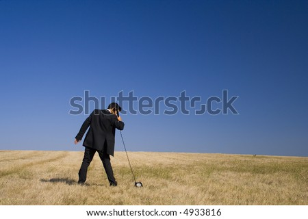 a businessman trying to communicate with Earth - stock photo