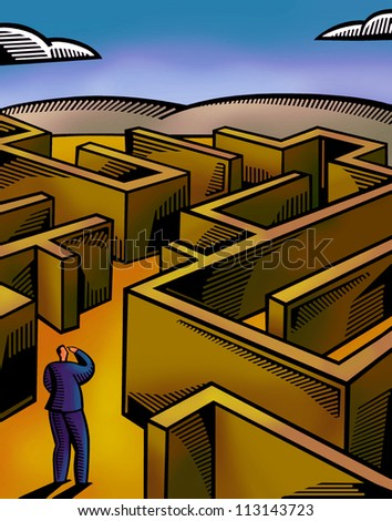 A businessman walking through a maze - stock photo