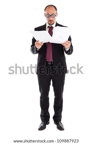 A businessman wearing thick, circle glasses tryng to read some documents - stock photo