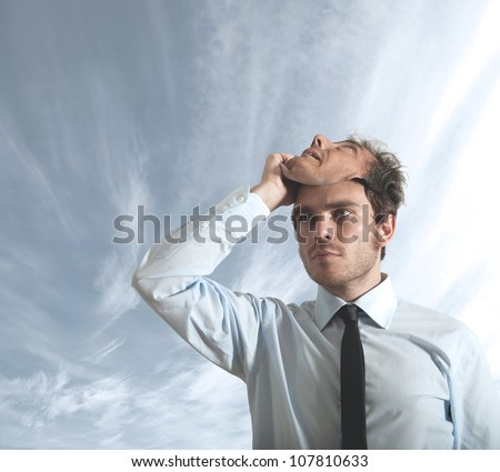 A businessman who hides behind a mask - stock photo