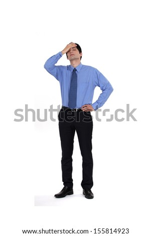 A businessman who made a mistake. - stock photo