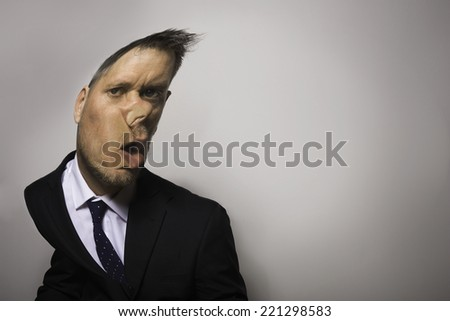 A businessman with his faced pressed up against an invisible glass wall.  - stock photo