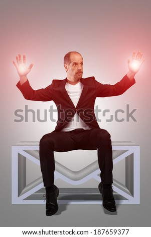 A Businessman with some magic capabilities is sitting on a virtual mailbox. - stock photo