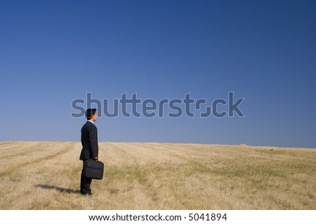 a businessman working in the nature - stock photo