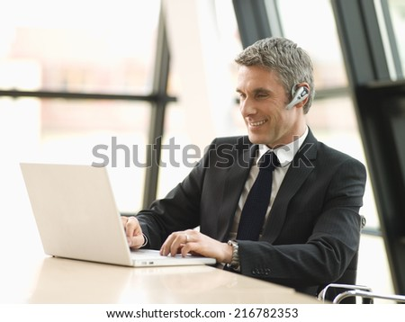 A businessman working on his laptop. - stock photo