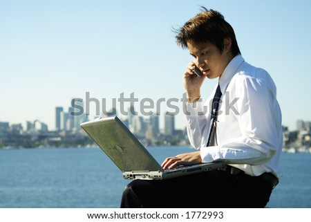 A businessman working outdoor at a park - stock photo