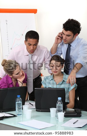 A businessteam at work. - stock photo