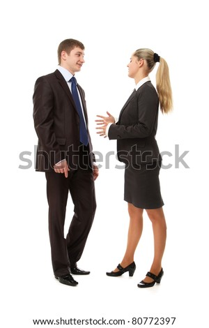 A businesswoman and a businessman are talking to each other - isolated on white background - stock photo