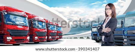 a businesswoman in front of cargo fleet - stock photo