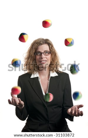 A businesswoman juggling balls on white background - stock photo