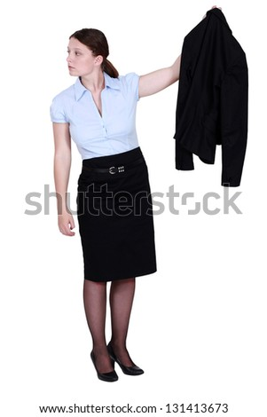 A businesswoman presenting her jacket. - stock photo