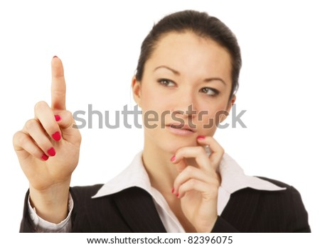 A businesswoman pushing with her finger, isolated on white - stock photo