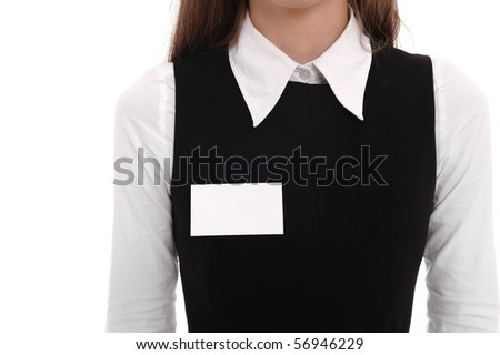 A businesswoman wears a blank name tag. - stock photo