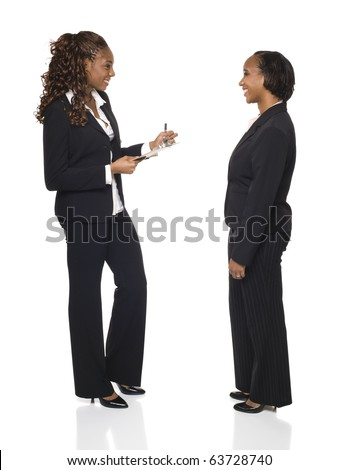 A businesswoman writes down answers on a questionnaire or fills out forms during an interview. - stock photo