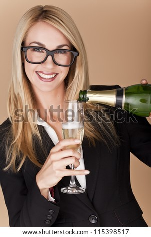 A businesswomen woman holding a glass of champagne at a party. Businesswomen celebrating. - stock photo