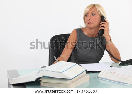 A busy businesswoman. - stock photo