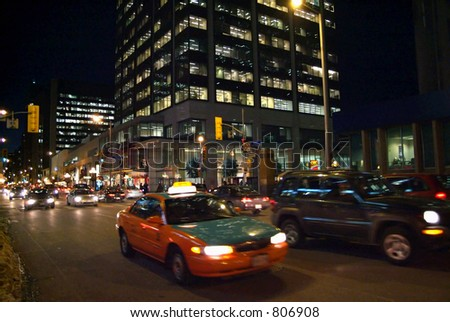 A busy downtown street at night. - stock photo