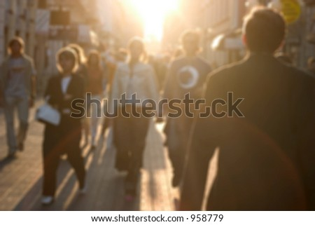 a busy european street. People are blurred with a lens. - stock photo