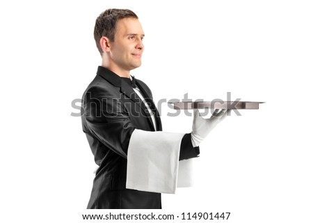 A butler with bow tie carrying an empty tray isolated against white background - stock photo
