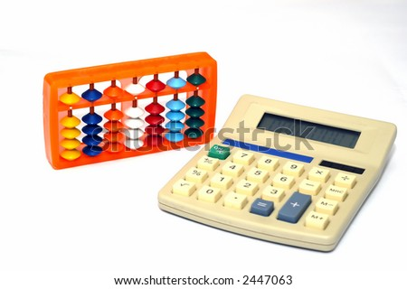 A Calculator and an abacus against a soft white background - stock photo