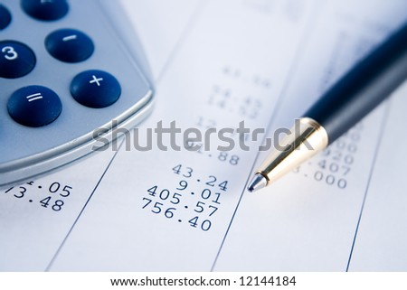 A calculator, pen, and financial statement. - stock photo