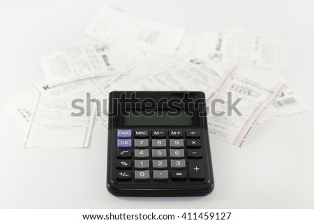 A calculator with receipt, household bills - stock photo