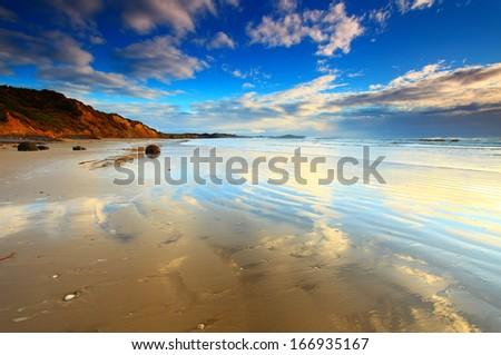 A calm morning view at Moeraki Boulders beach, New Zealand - stock photo