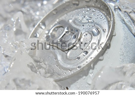 A can of soda in middle of ice cubes. - stock photo