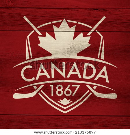 A Canadian hockey crest on a rustic wooden background. - stock photo