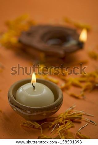 A candle in an indian earthen holder - stock photo