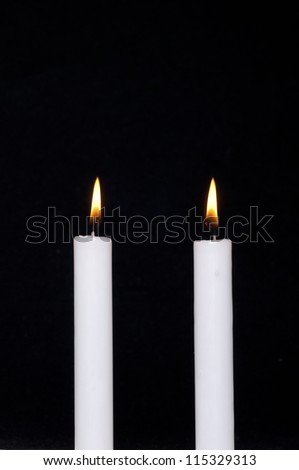 A candle on black background - stock photo
