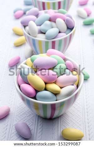 A candy buffet featuring bright and colorful jordan almonds. - stock photo