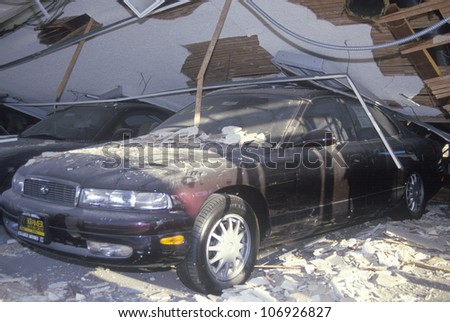 A car at a Mazda dealership crushed in the Los Angeles earthquake of January 17, 1994 - stock photo
