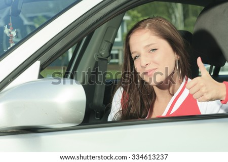 A Car driver happy showing is thumb up. - stock photo