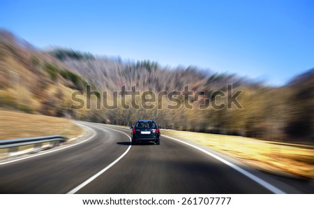 A car driving with high speed with blur background - stock photo