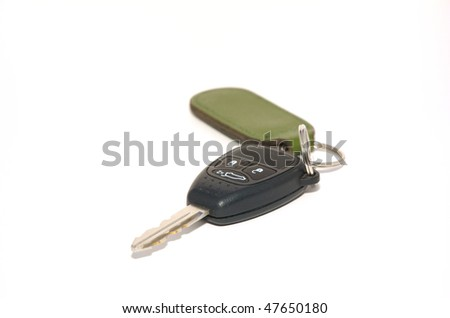 A car key with remote unlocking on a white background - stock photo