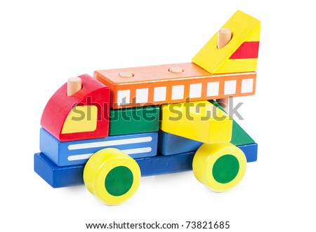 A car made of wooden colorful blocks buildings isolated over white - stock photo