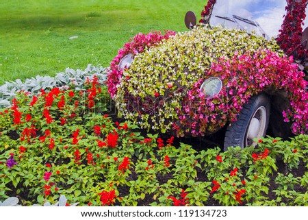 a car maded from lot of flowers - stock photo
