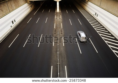 A car moving through the tunnel - stock photo