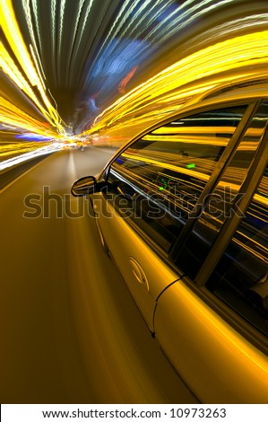 A car racing along a motorway, surrounded by streaks of light of overhead street lights and route information - stock photo
