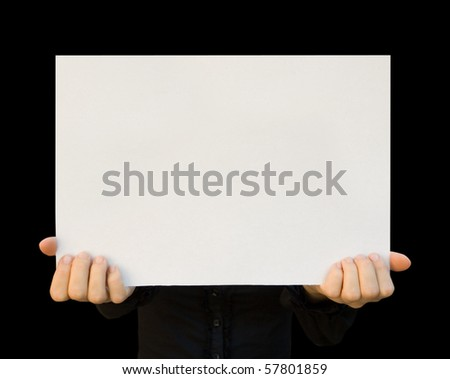 a card blank in a hand on the black - stock photo