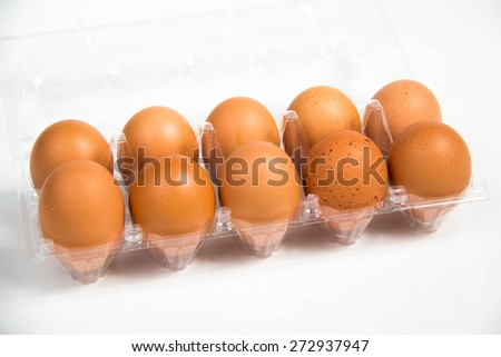 A carton of fresh free range egg on a white background.  - stock photo