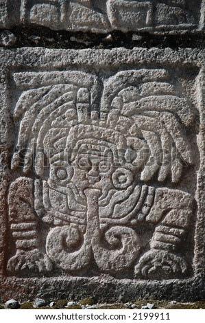 a carving in one of the columns in chichen itza - stock photo