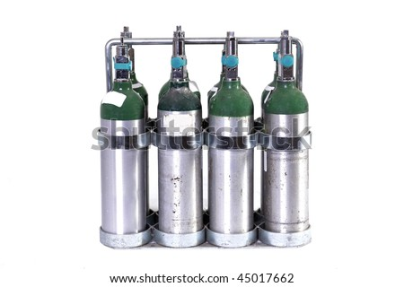 a case of 8 oxygen tanks isolated on white - stock photo