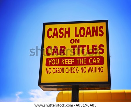 a cash loan or car title loan sign in the summer time toned with a retro vintage instagram filter app or action effect  - stock photo