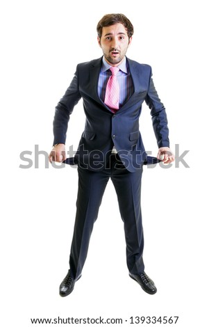 A cash strapped young executive isolated on white - stock photo