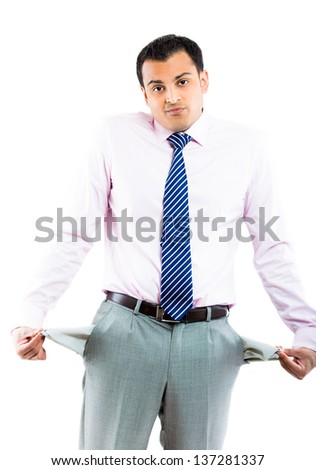 A cash-strapped young executive wondering where all his money has disappeared to - stock photo