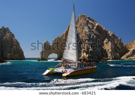 A catamaran at the famous Los Arcos in Cabo San Lucas, Mexico. - stock photo
