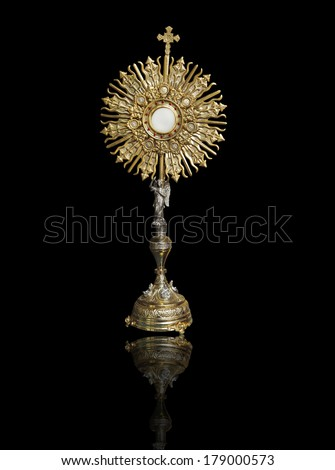 A Catholic priest santisimo host at Communion - stock photo